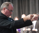 David Littrell and the K-State Orchestra perform a commemorative piece.