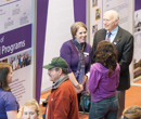 Guests peruse exhibits from 31 colleges, offices, and departments detailing the university's history.