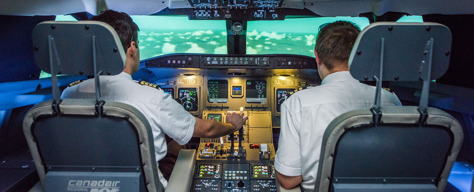 Two students piloting a plane