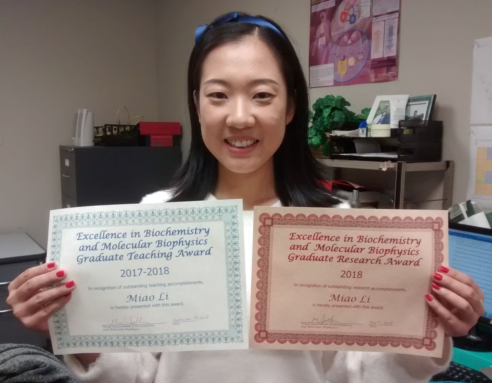 Miao with two awards
