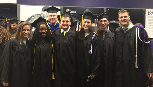 BMB graduates with department head at commencement