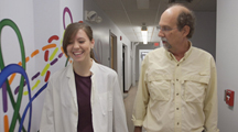 Image of Dr. Tomich with student and link to Dr. Tomich's YouTube research video