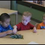 "The children took turns touch the ""spikey"" leaves."
