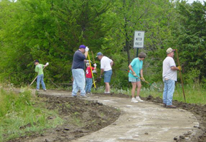 Photo of volunteers putting in a walking trail in Overbrook, Kan.