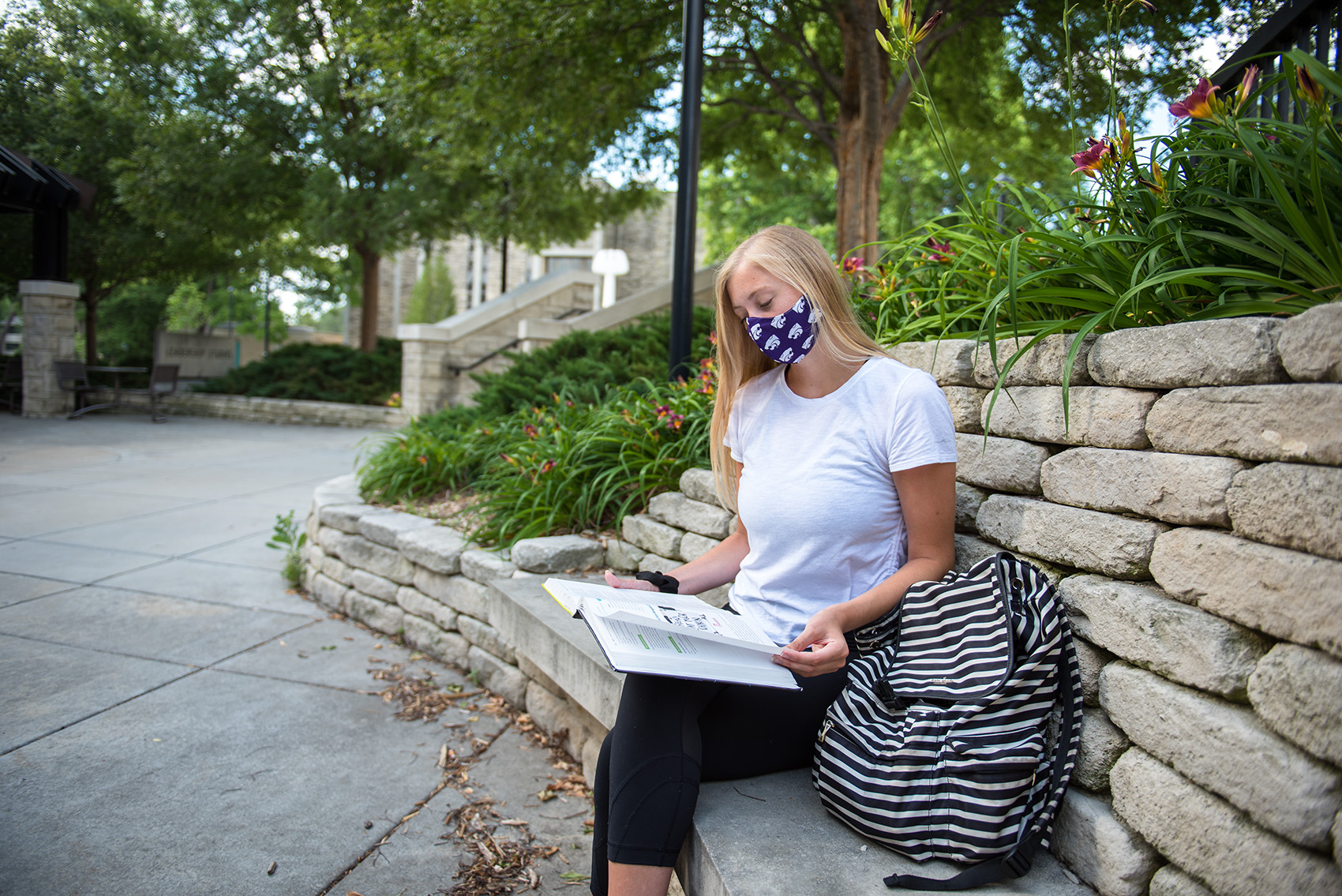 Student in mask studying on campus