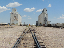 Train tracks between Goodland, KS, grain elevators