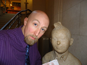 Joe Sutliff Sanders and a statue of Tintin