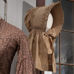 Linen prairie bonnet in Forces exhibit