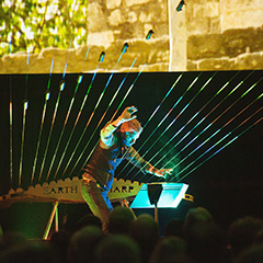 William Close playing earth harp