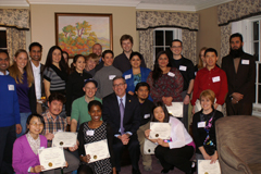 Postdocs and students with President Schulz