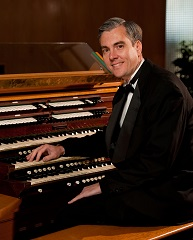 David Pickering at All Faiths Chapel organ console