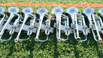 Trumpets line the football field at Bill Snyder Family Stadium