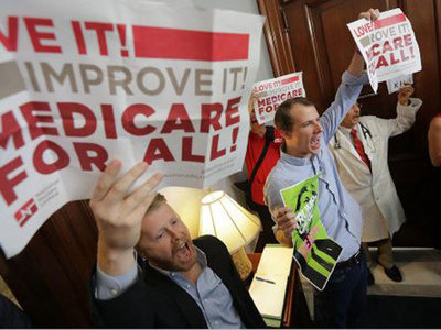 Jon Schaffer and Phil Garrity, two health activists trained by Paul Davis, protest the repeal of the Affordable Care Act in front of Senate offices in Washington, D.C.