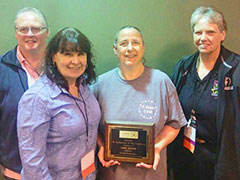 Lesa Reves receives technician of the year award