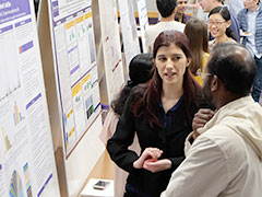 Second-year student Meghan Lancaster explains her poster research project