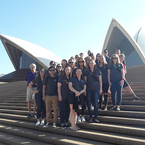 The group poses in front of the Sydney Opera House