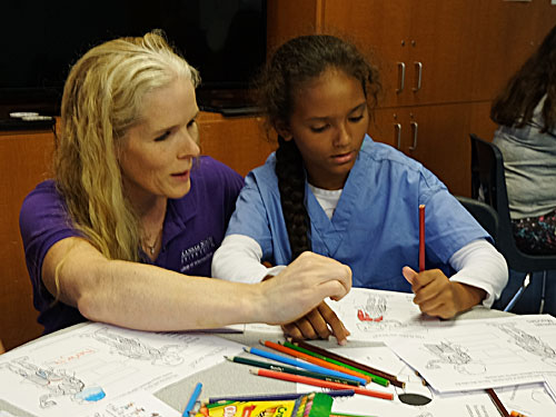 Dr. Kate KuKanich works with a student at the Boys & Girls Club of Manhattan