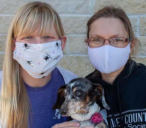 Drs. Jessica Meekins and Lisa Pohlman with foster dog Poppy