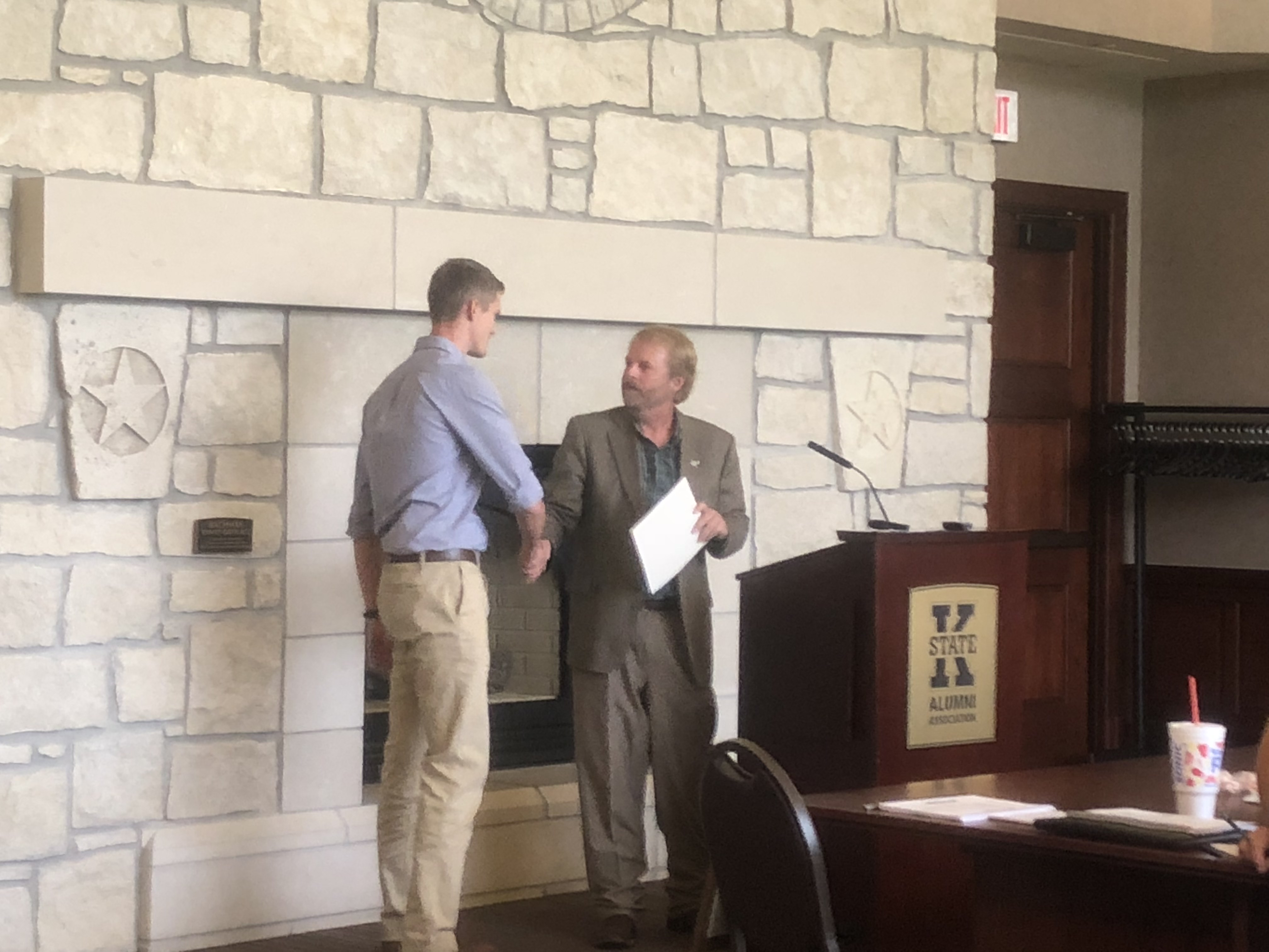 Chris receiving the outstanding Student Award from Dr. Haukos