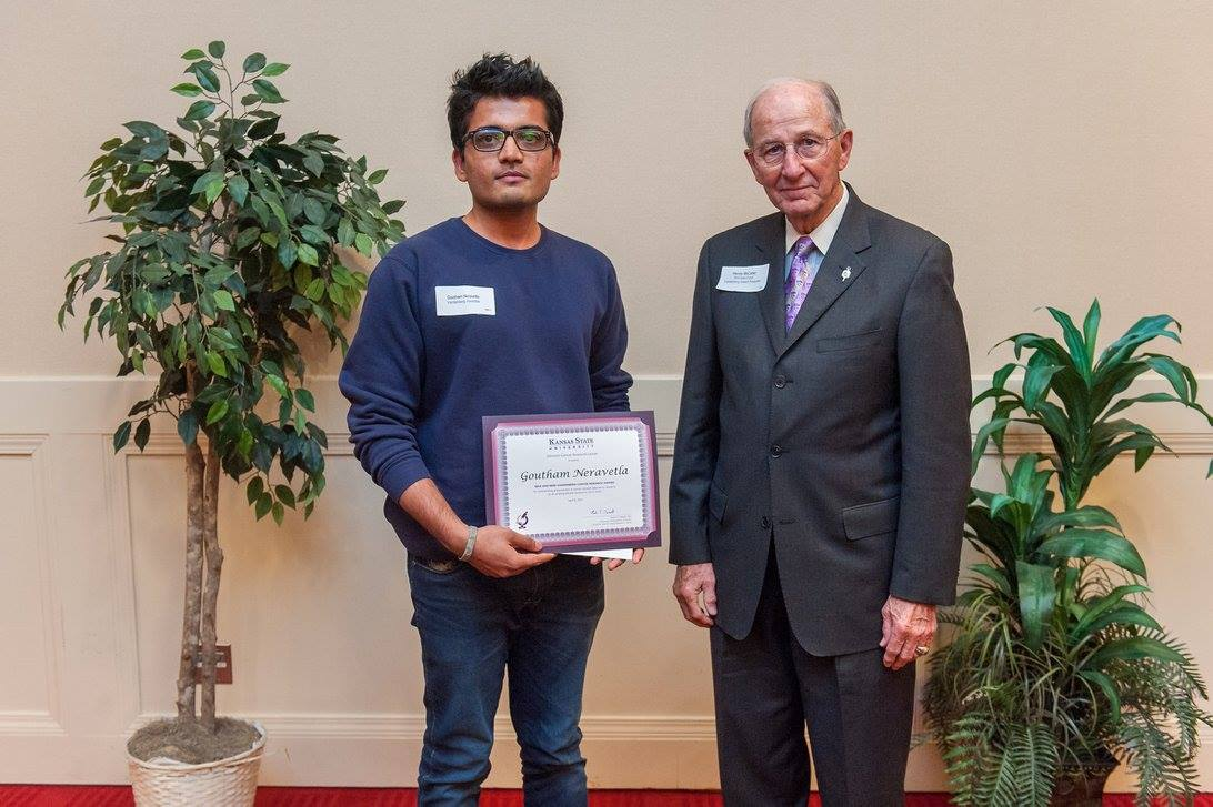 Goutham Neravetla recieving the Riva and Mike Vandenberg Award from Harvey McCarter