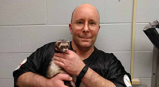 Owner Carl Hobi and his ferret Zelda