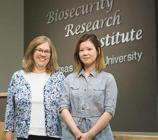 Kansas State University's Dana Vanlandingham, associate professor of diagnostic medicine and pathobiology, left, and Soo Lee Park, third-year veterinary student and concurrent doctoral student in pathobiology