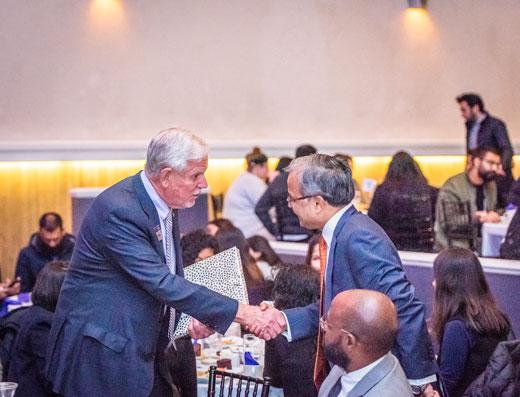 President Richard Myers shakes hands with Ambassador Asad Majeed Khan.