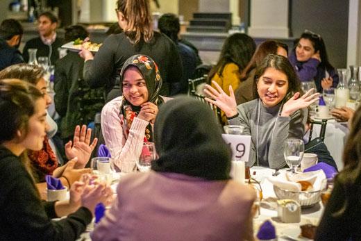 Pakistani Fulbright students talk over dinner.
