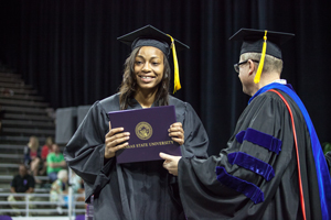 A student-athlete receives her degree