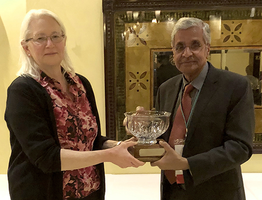 Dr. Amelia Woolums, president of ACVM, presents the microbiologist of the year award to Dr. T.G. Nagaraja.