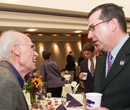 President Schulz visits with a K-State supporter at a grain science event.