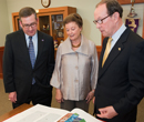 Schulz peruses the St John's Bible with Mary Lynn and Warren Staley, whose donation helped secure the creative work for the university's collection.