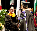 President Schulz congratulates a graduate at the College of Business Administration commencement.