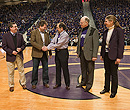 Recognition of Dr. Juergen Richt at K-State basketball game with Dr. Ron Trewyn, Dr. Ralph Richardson and Dr. April Mason.
