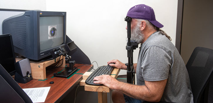 A participant uses eye tracking technology