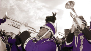 Closeup of several marching band members playing